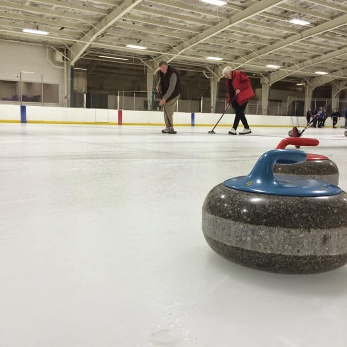 couple at an intro to curling session with Cincinnati Curling Club