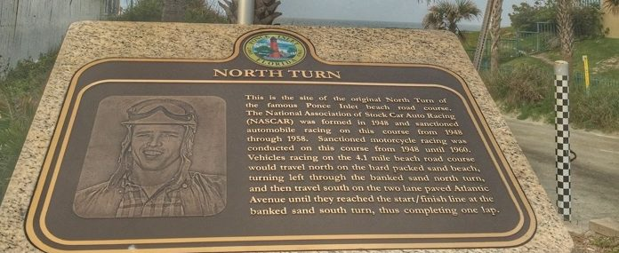 Historical marker for race start at Racing's North Turn Beach Bar & Grille in Daytona Beach, FL