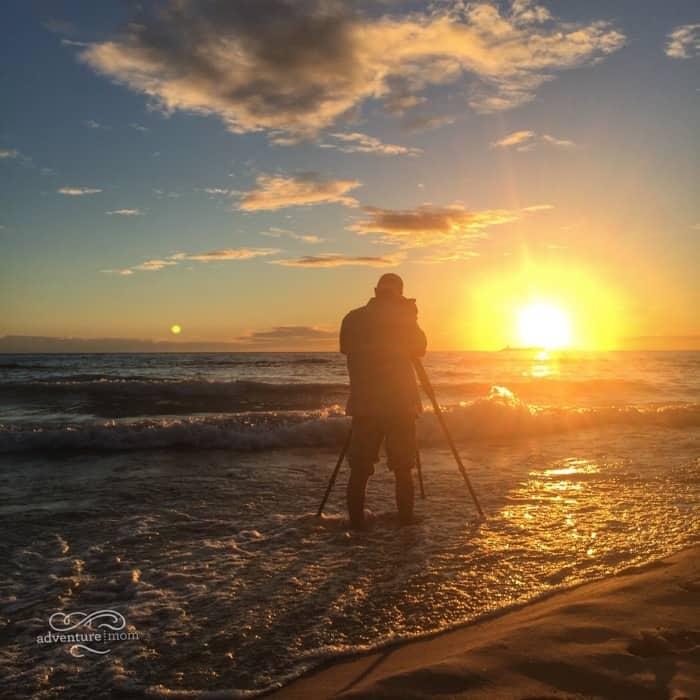 photographer during sunset Lake Michigan