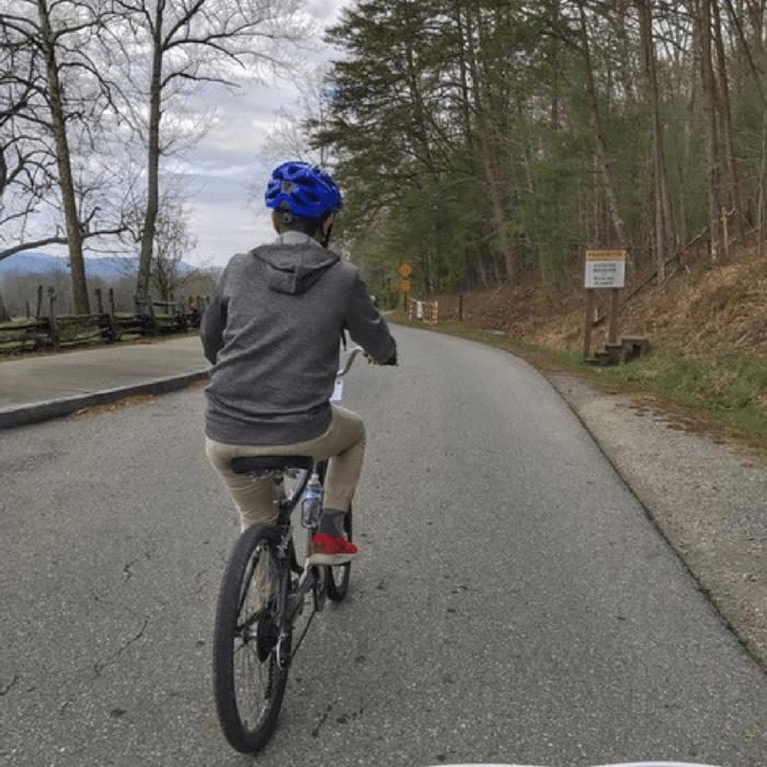 boy biking on Cades Cove loop