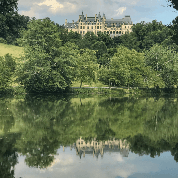reflection of The Biltmore Estate in the lagoon
