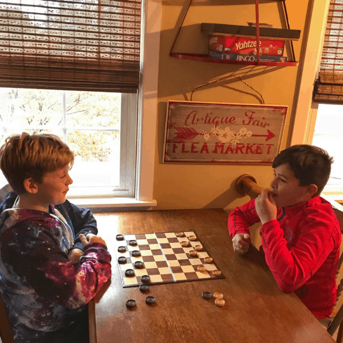 kids playing checkers in the common area at Carriage Lane Bed and Breakfast
