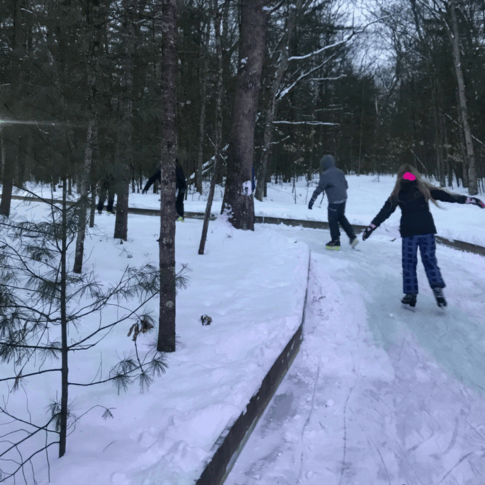 Ice skating trail in woods at Muskegon Winter Sports Complex