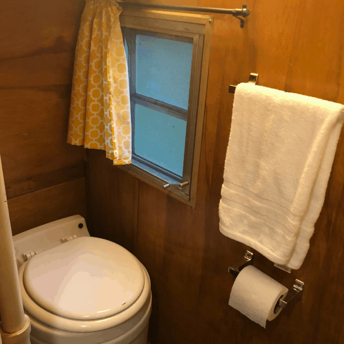 laveo dry flush toliet inside a vintage Winnebago rental from Route Fifty Campers