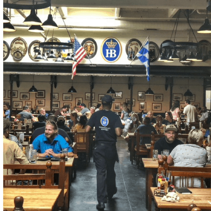 bavarian style tables for dining indoors at Hofbrauhaus Newport