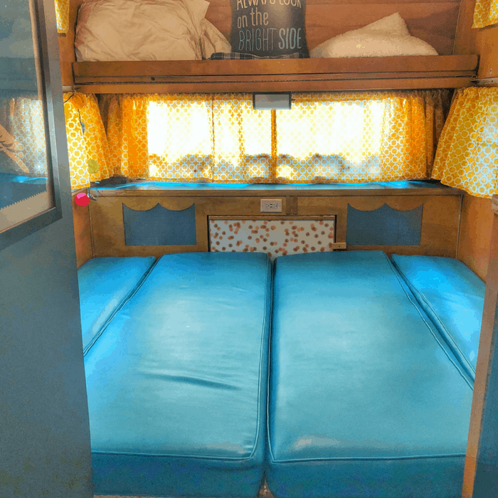 King Size bed in a vintage Winnebago rental from Route Fifty Campers