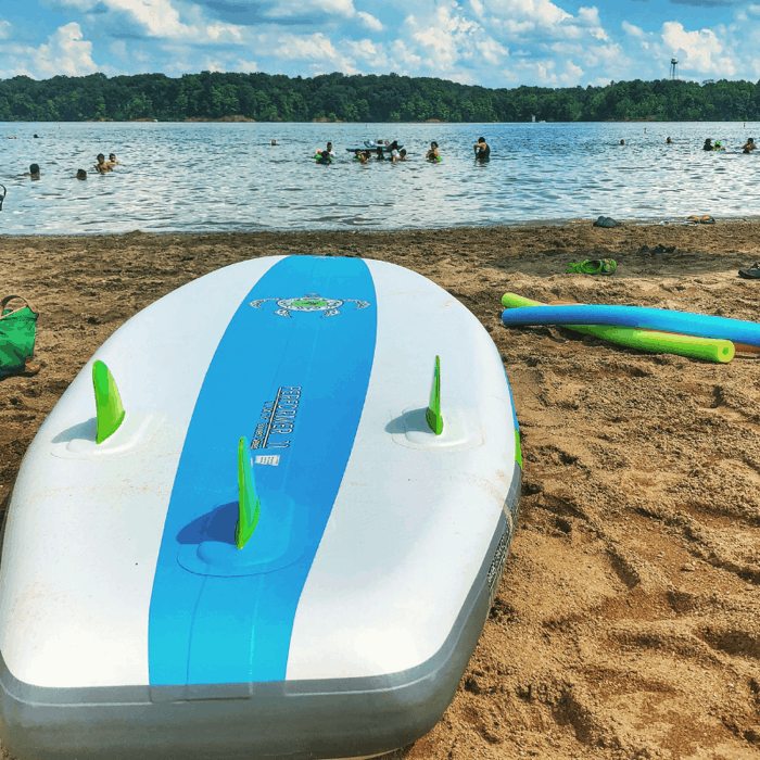 Bodyglove iSUP inflatable stand up paddle board on a beach