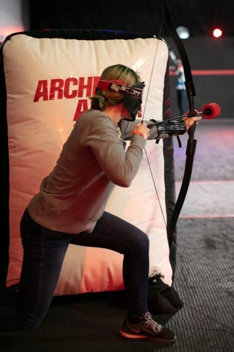 woman playing combat archery