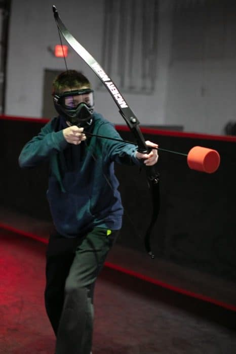 teenager playing at Archery Arena