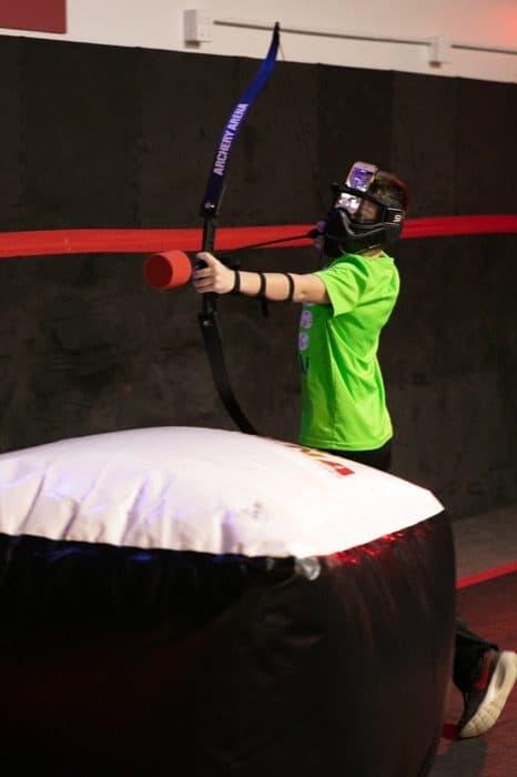 boy playing combat archery