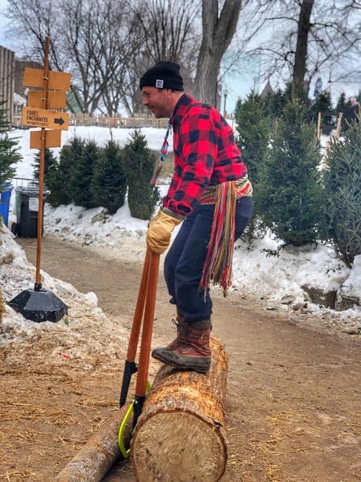 balancing on a log at the winter carnival