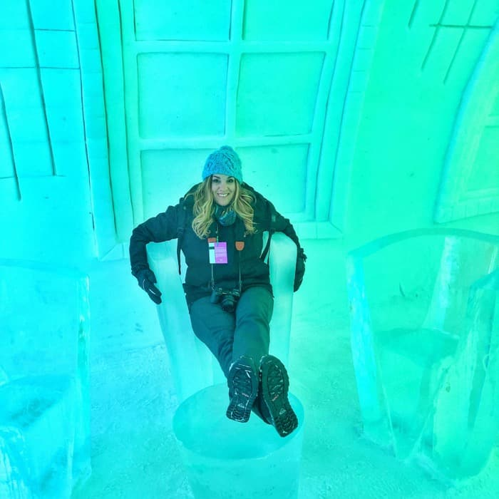 Adventure mom sitting in an ice chair at Hotel de Glace