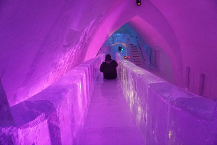 man on Slide Made of Ice at Hotel de Glace