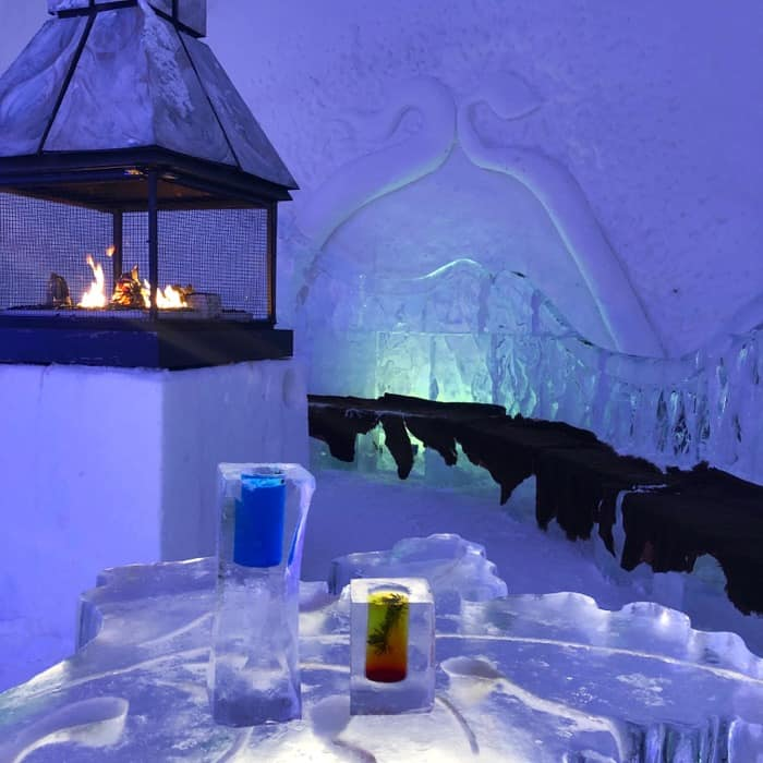 fireplace by the seating area by the Ice bar at Hotel de Glace Ice Hotel