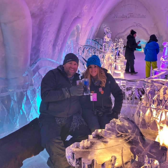 Adventure mom and husband at the  Ice bar at Hotel de Glace Ice Hotel