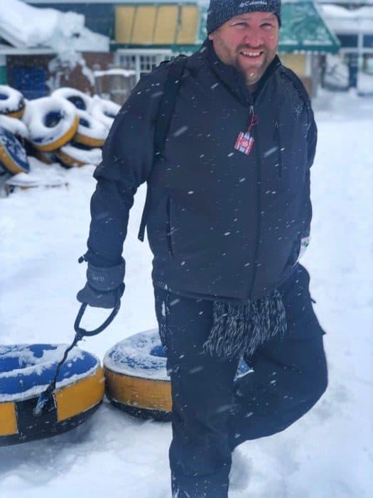 man snow tubing at Hotel Valcartier
