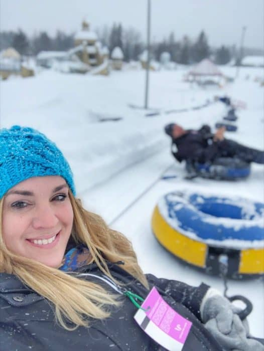 adventure mom and husband snow tubing at Hotel Valcartier