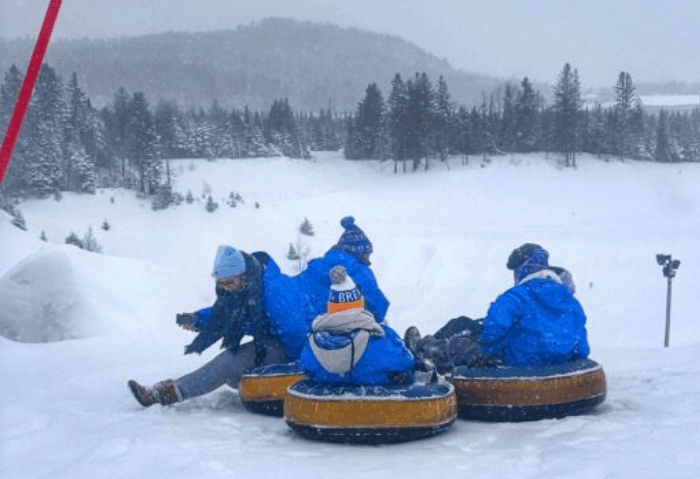 friends snow tubing at Hotel Valcartier