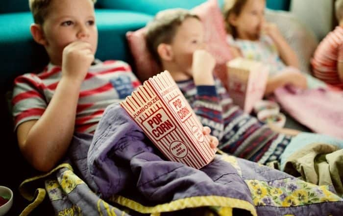 kids eating popcorn during a movie