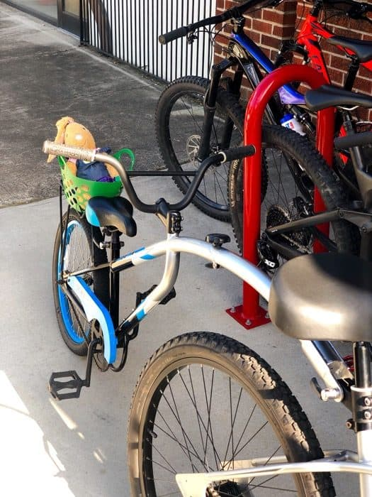 child's toy on a bike seat