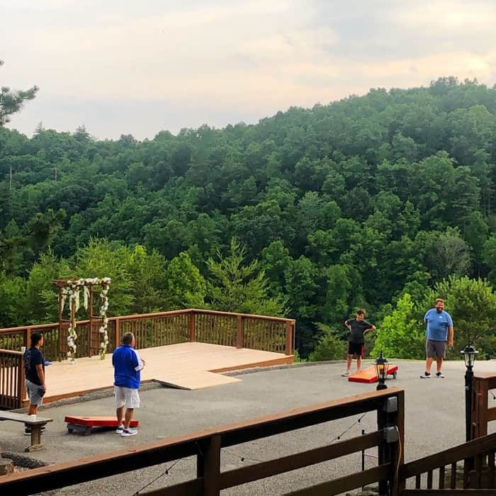 family playing cornhole at Cliffview Resort