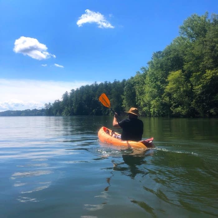 man Kayaking at Paddy's Creek Recreation Area at Lake James State Park