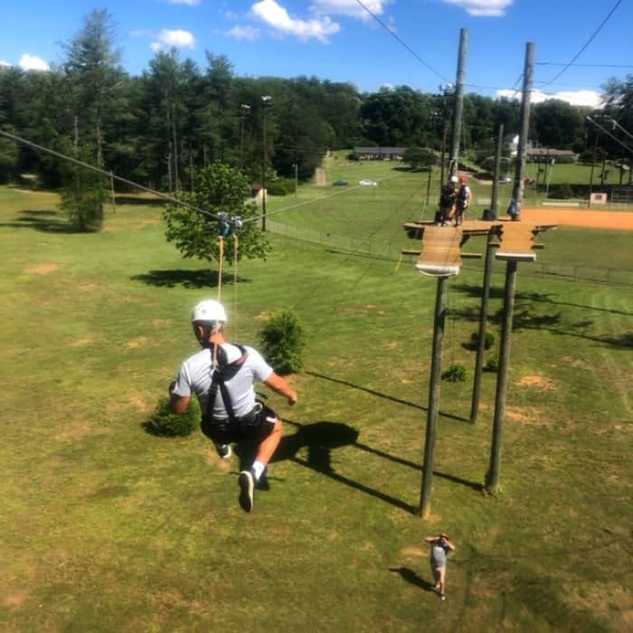 teenager ziplining Beanstalk Zip Line Journey at Catawba Meadows Park