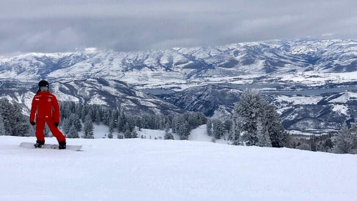 snowboarder at Snowbasin Resort in Utah
