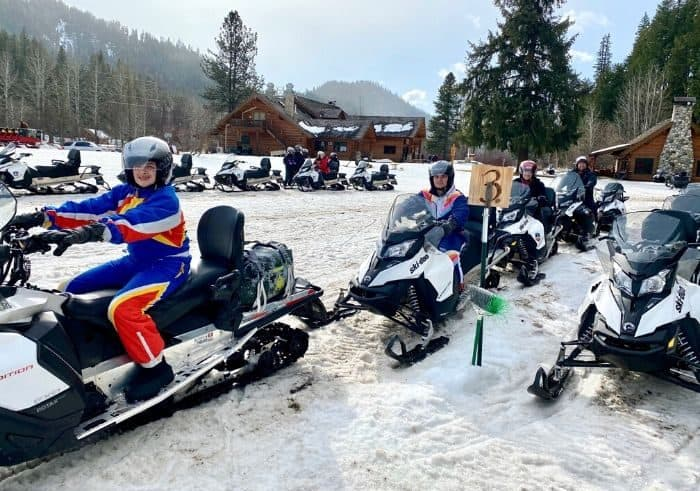 family on Guided Tour with Leavenworth Snowmobile Tours