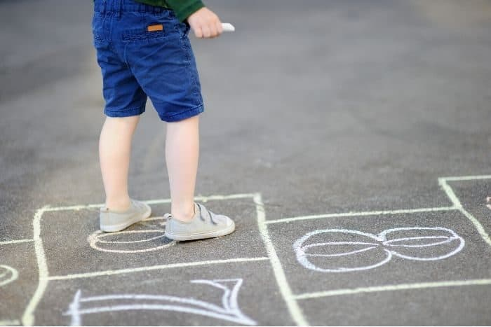 kid playing hopscotch
