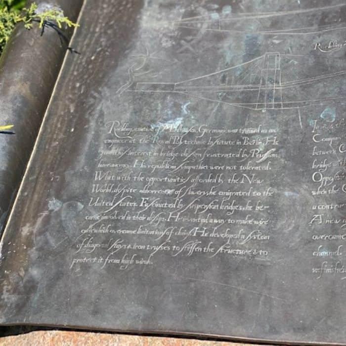closeup of marker near John A. Roebling statue in Covington Kentucky