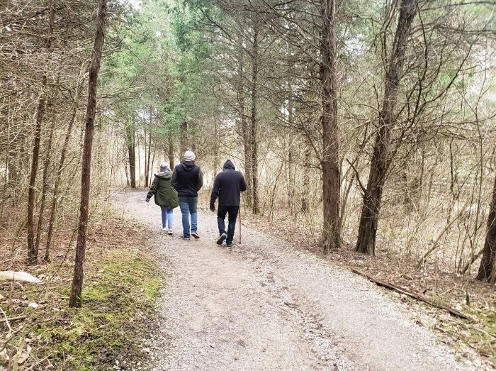 family hiking on a trail