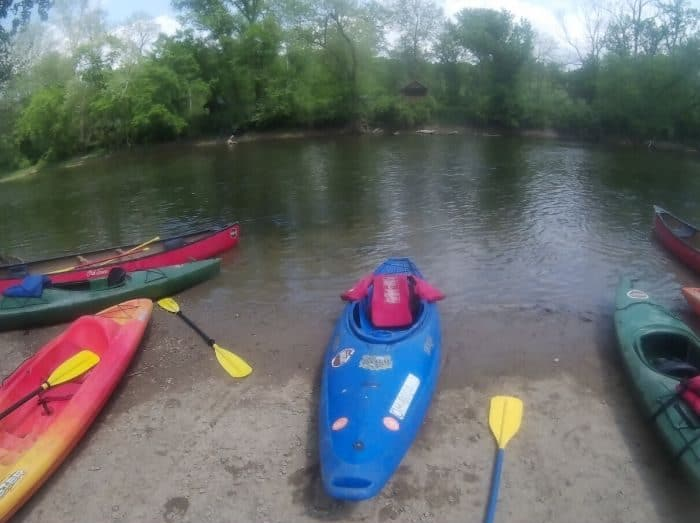 kayaks by the river