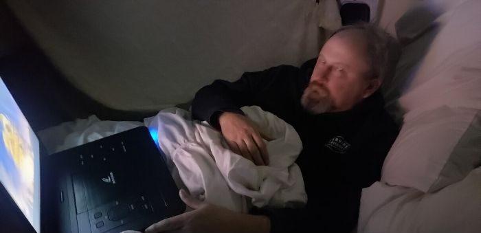 watching a movie in a van camper