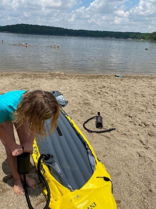 girl inflating a kayak