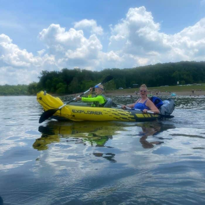 Mother and son on an inflatable kayak