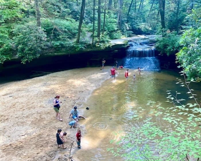 sandy beach Creation Falls waterfall at Red River Gorge