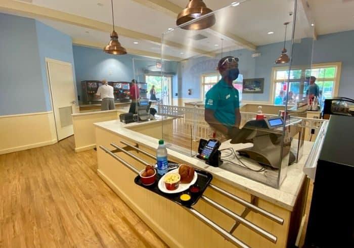 employee behind plexiglass at Kings Island