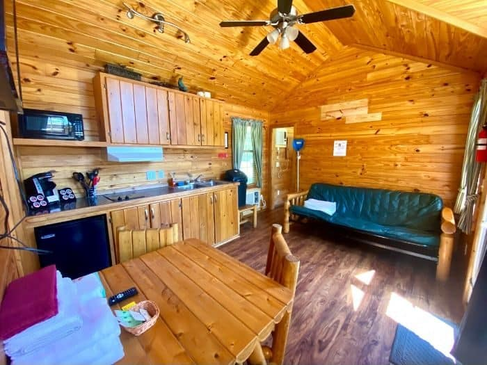 kitchen and family room the Deluxe Cabin at Port Huron KOA Resort
