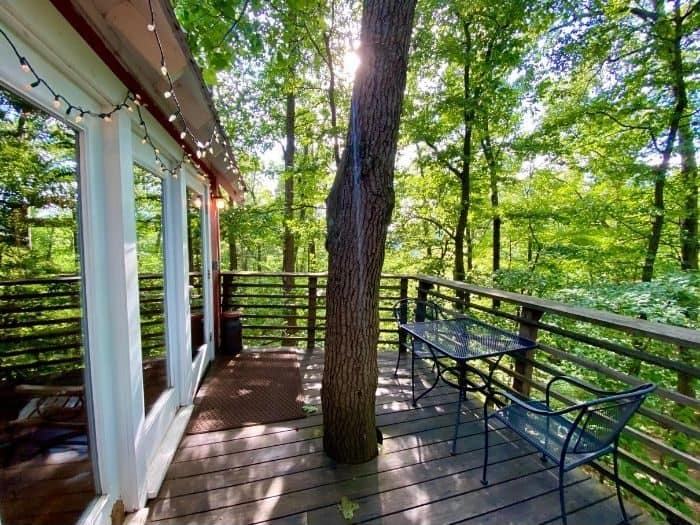 deck with seating at the Little Red Treehouse at the Mohicans