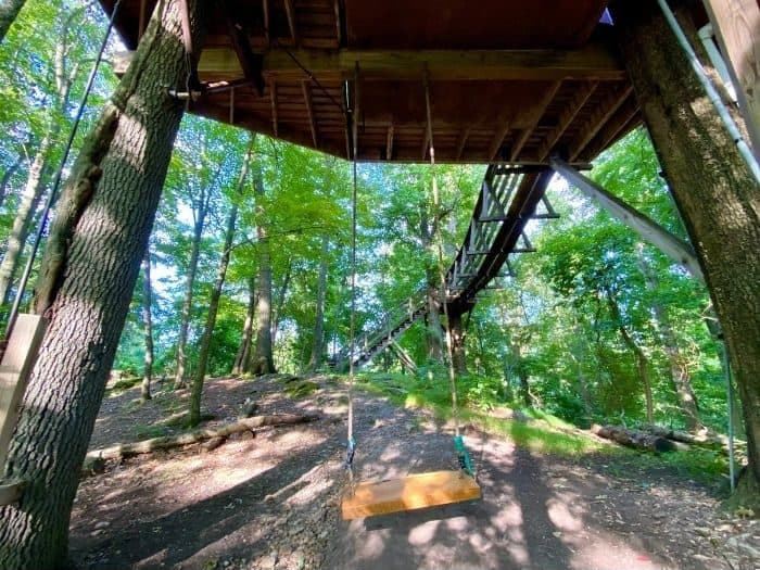 swing underneath the Little Red Treehouse at the Mohicans