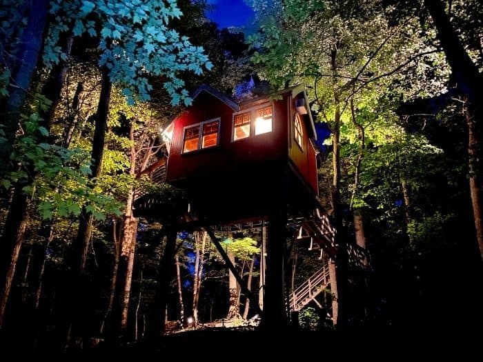 view of the Little Red Treehouse at the Mohicans at night