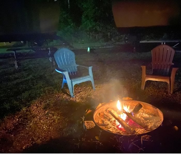 campfire by the Covered wagons at Sheltowee Trace Adventure Resort