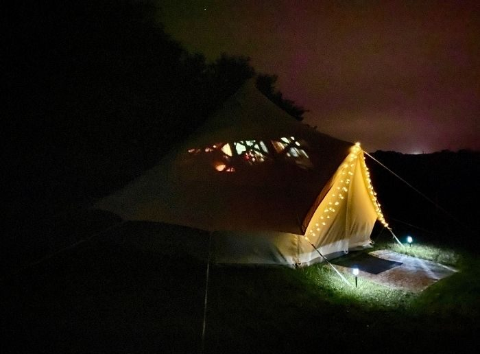 movie projector inside glamping tent with the Pop-up BNB