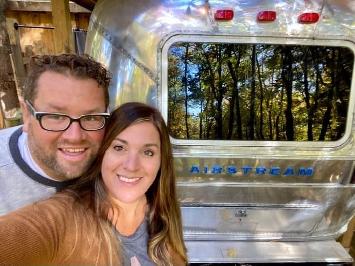 Nedra McDaniel and husband at the Silver Bullet Airstream treehouse