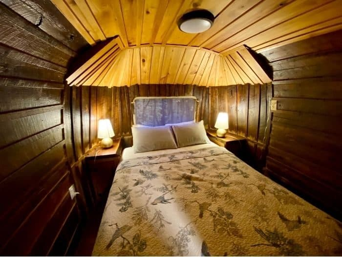 bedroom inside The Silver Bullet Airstream Treehouse at The Mohicans
