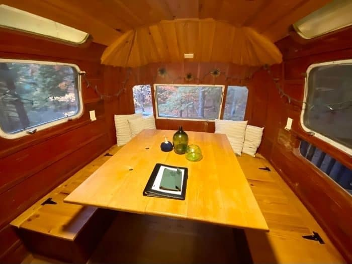 dining table inside the Airstream treehouse at The Mohicans