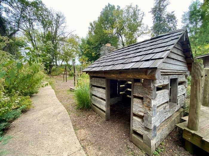 log cabin playlhouse at Nature play at the Behringer-Crawford Museum