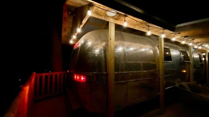 the Silver Bullet Airstream treehouse at night