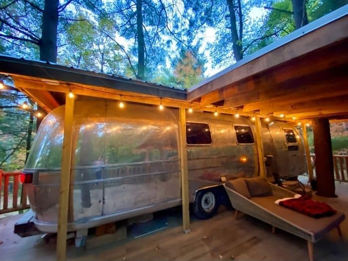 the patio deck for The Silver Bullet Airstream Treehouse